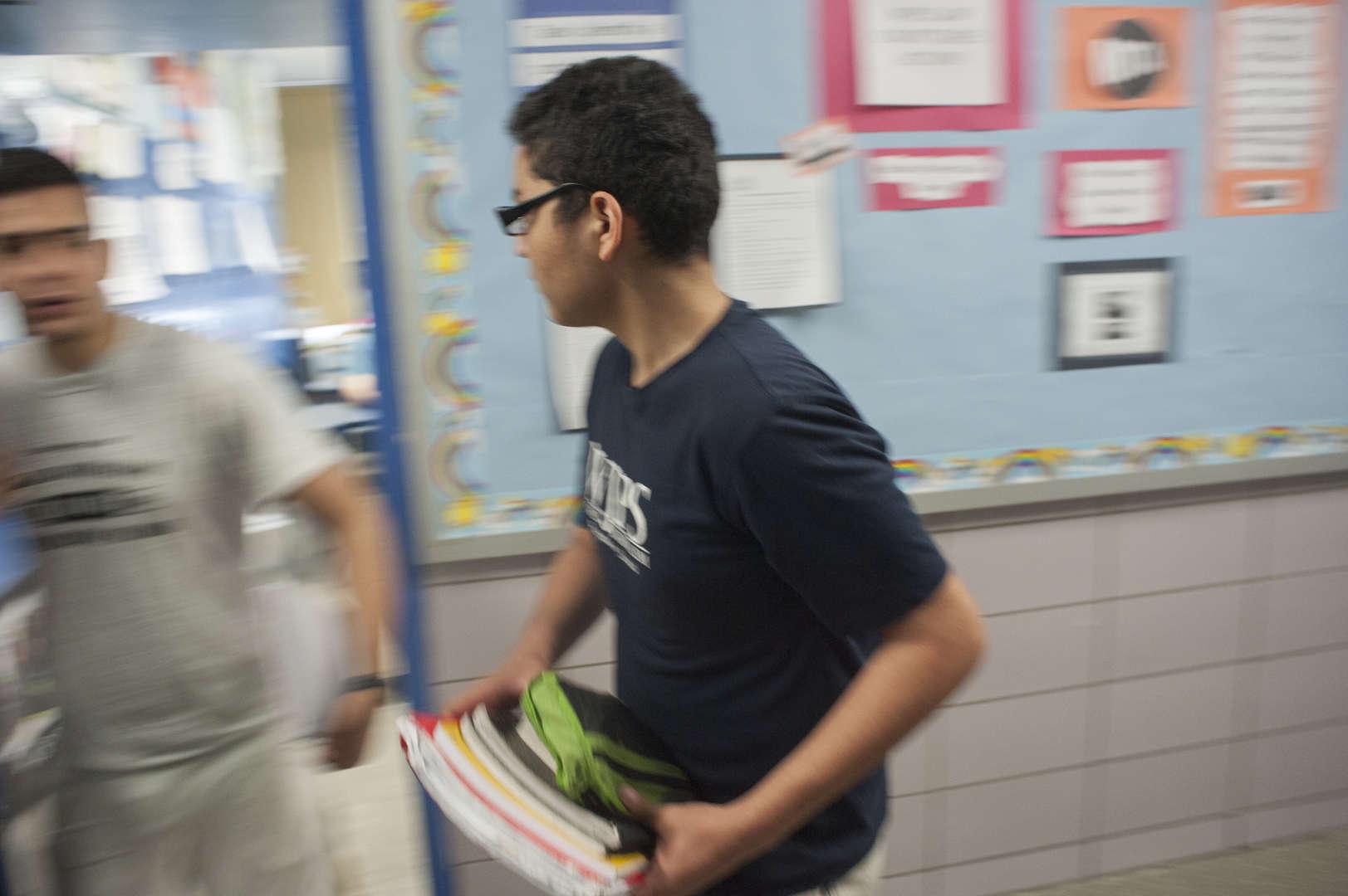 student holding school books