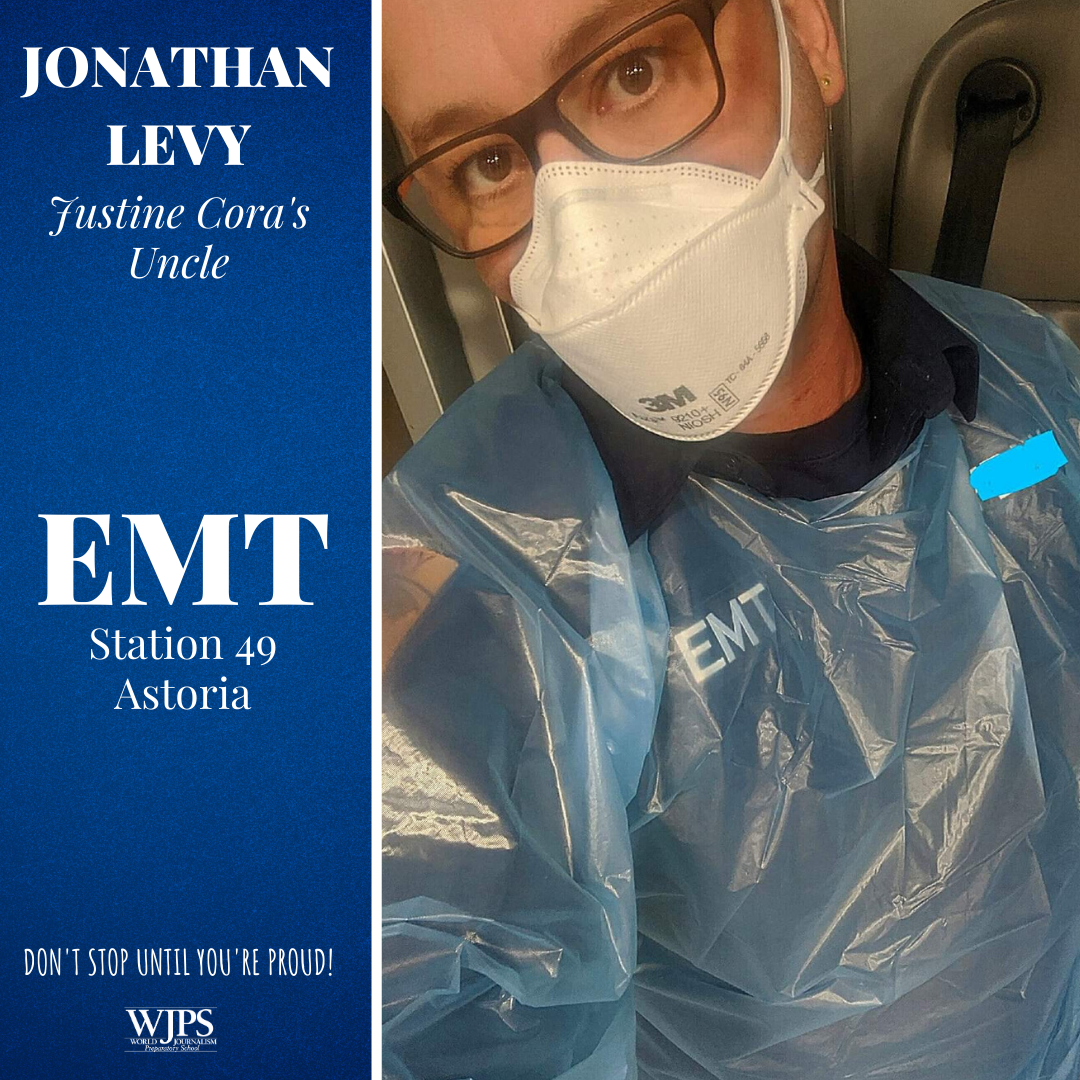 male EMT worker in medical mask and blue PPE