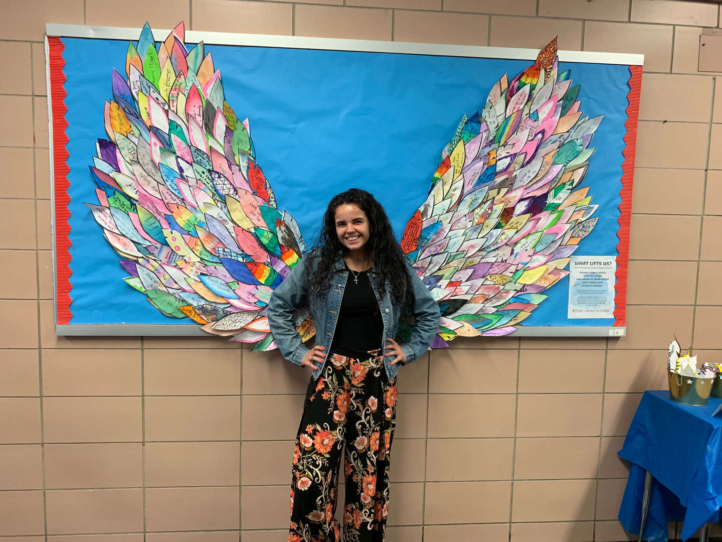 female student with paper wings