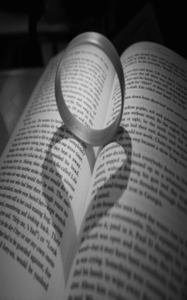 book with ring light creates heart shadow