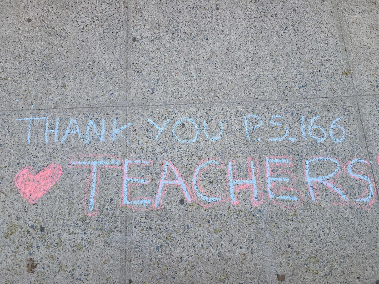 Thank you teachers message in chalk on sidewalk