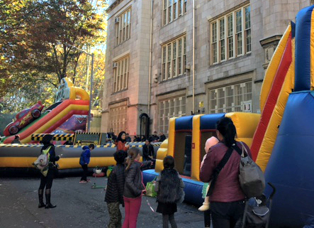 View of 89th Street with Fall Fest Bounce Houses