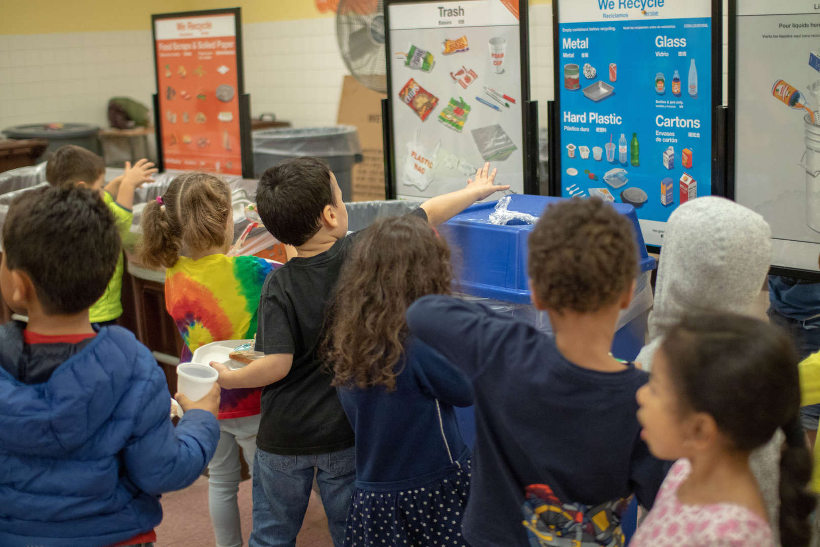 Children Sorting Their Lunch Garbage in Trash, Recycle Bin, and Compost Bin