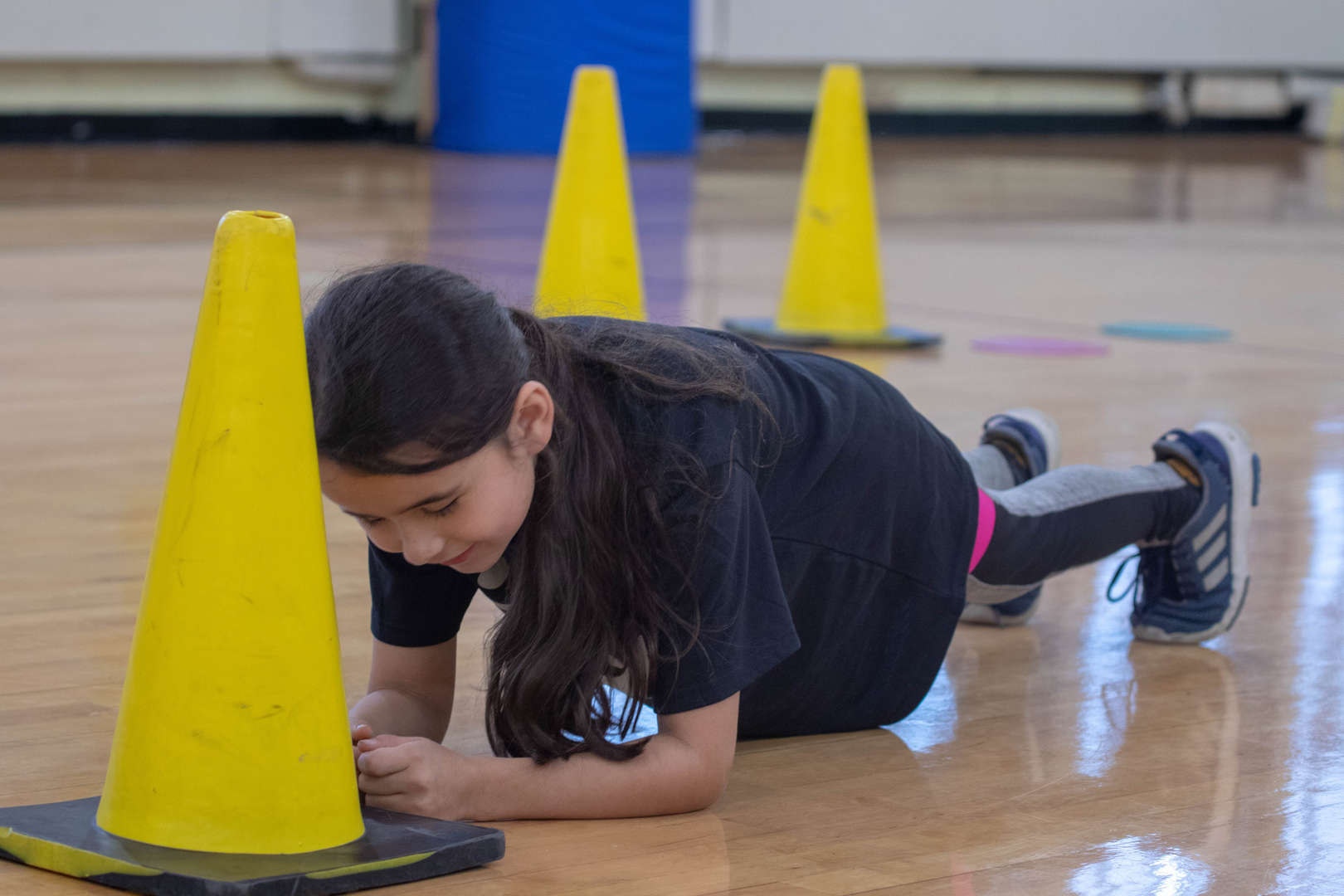 Fourth Grade Girl Doing Plank in Gym