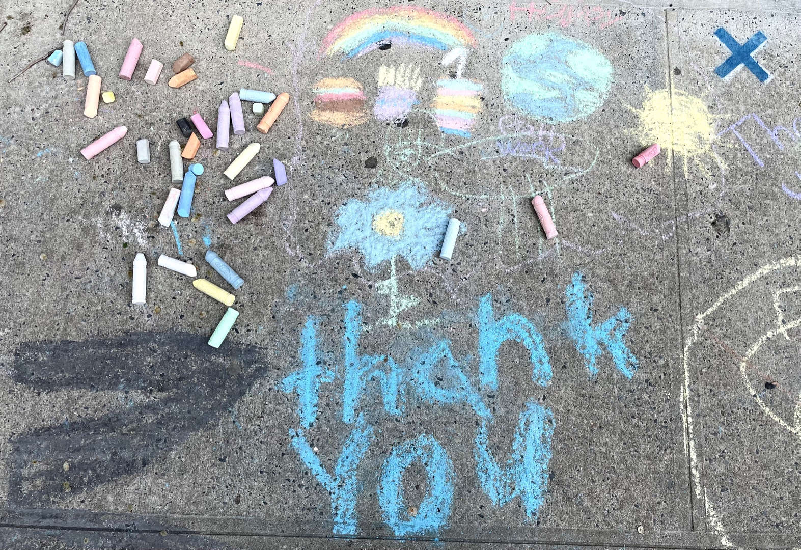 Thank you teachers message in chalk on sidewalk