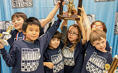 Manhattan Knights Chess Team Holding Trophy