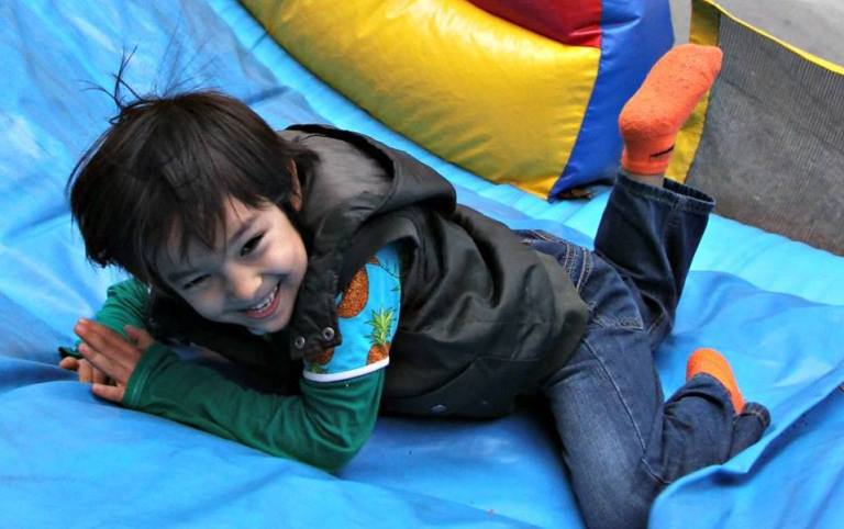 Boy in Bounce House