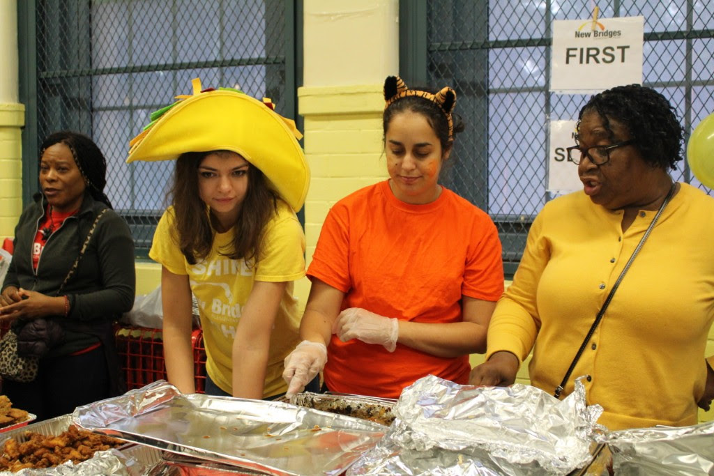 Teachers in Costume Serving Food