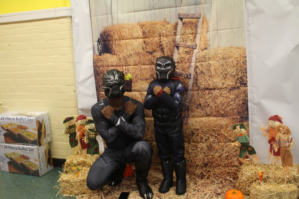 Teacher and Child in Black Panther Costume