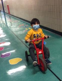 PreK student riding a bike