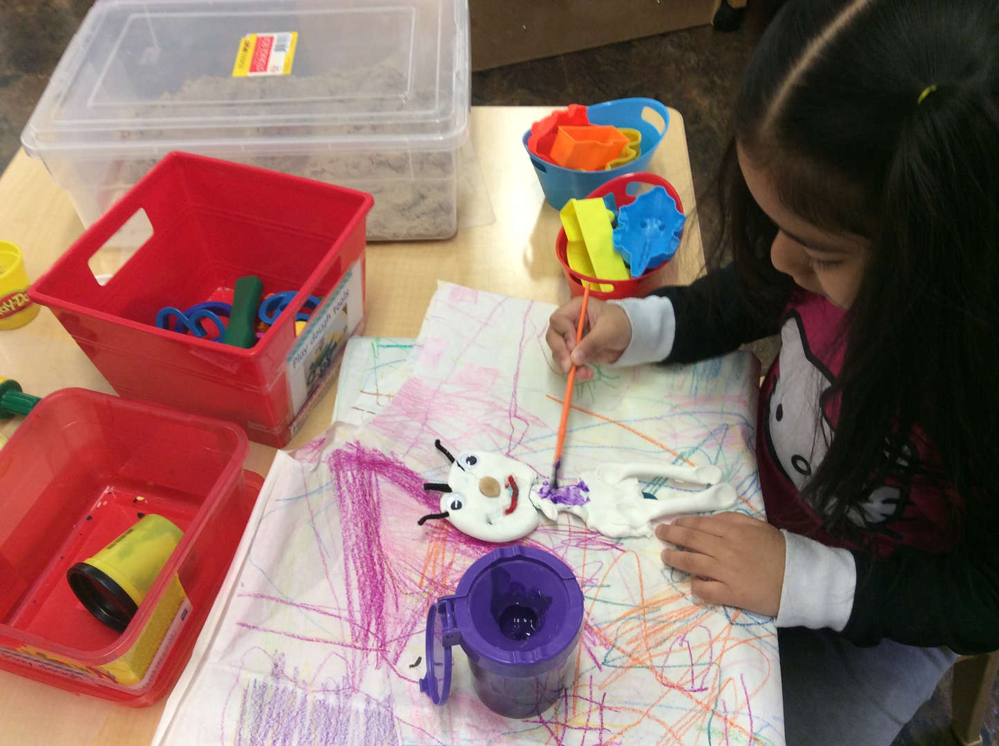 Student painting an arts and crafts project