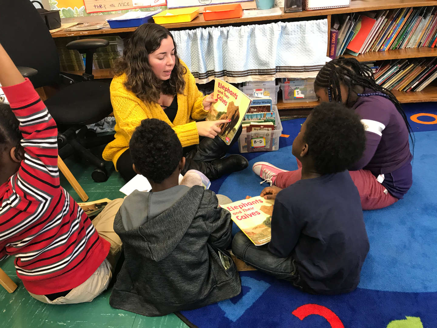 Students participating in a read aloud