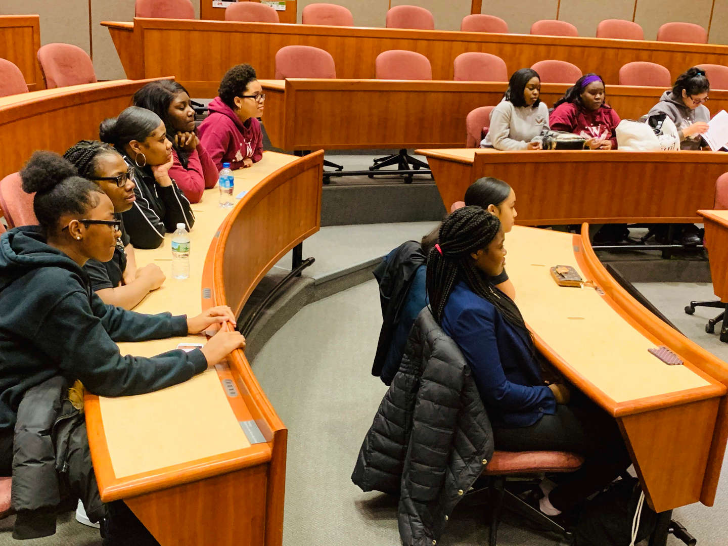 Scholars Listening in a Courtroom