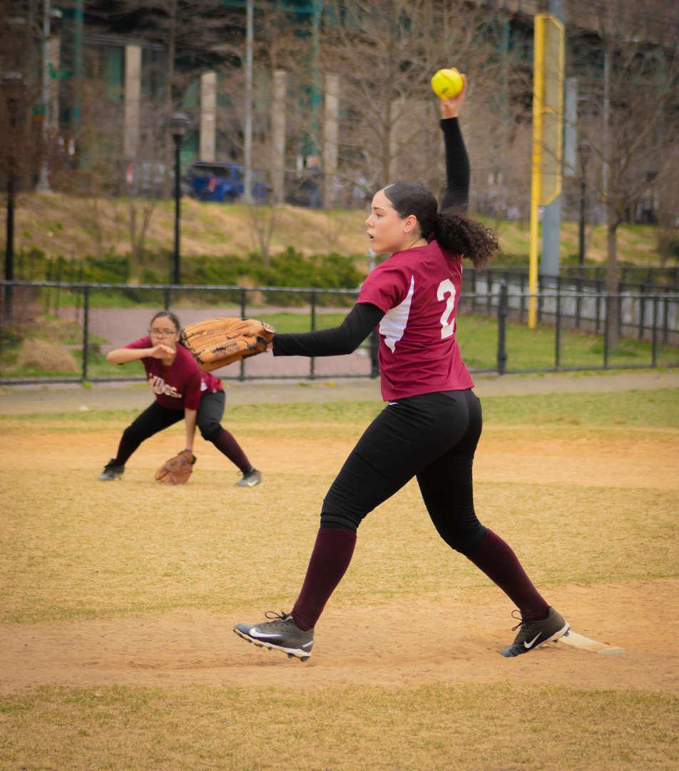 Student pitching ball