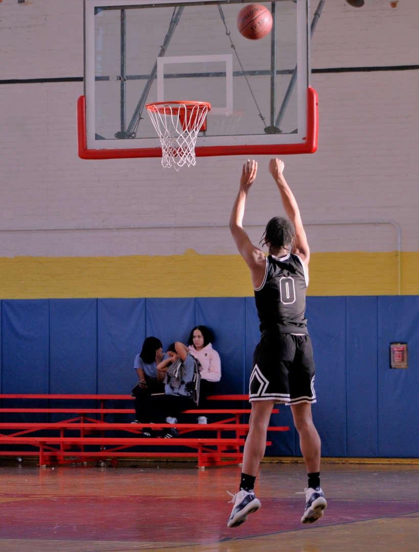 Basketball player aiming for basket