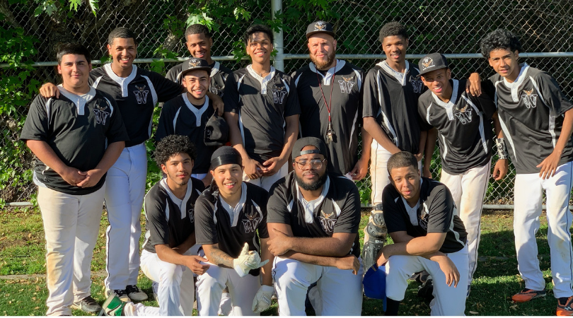Baseball team posing together