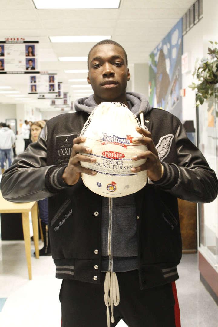 Student holding cap