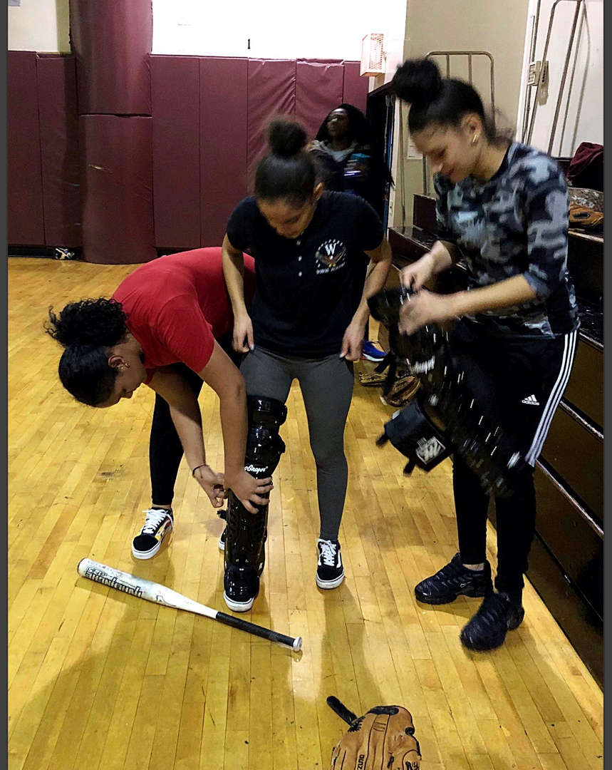 Student helping another with their leg brace