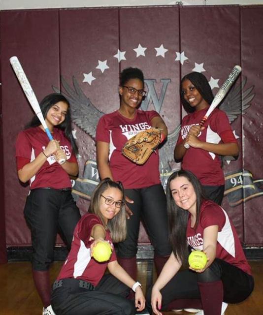 Students posing with baseball equipment