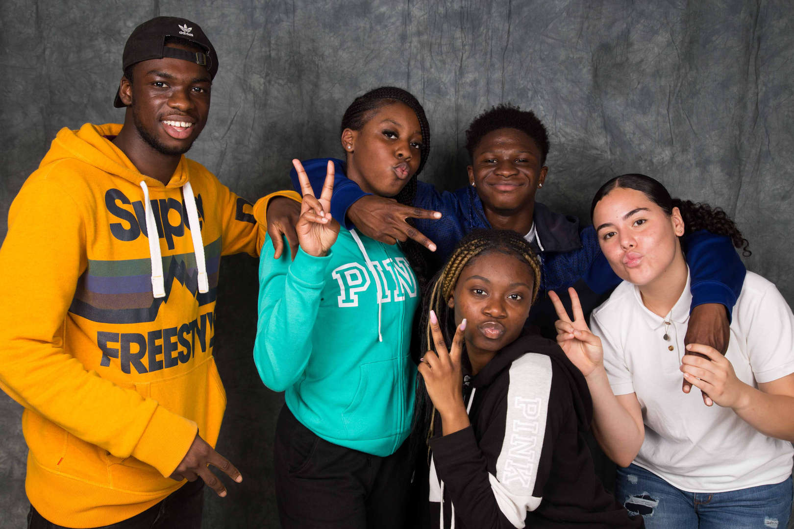 Five students posing together
