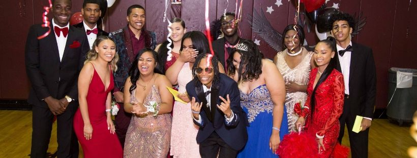 Students posing together for prom night
