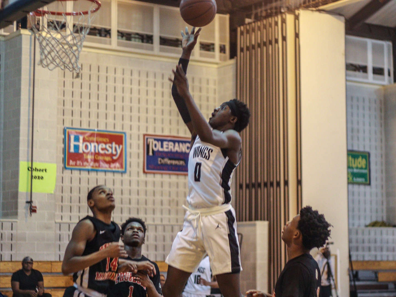 Student throwing basketball to hoop