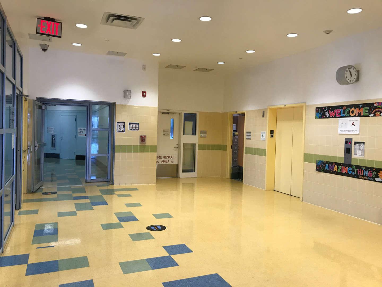 Upper floor hallway view by the elevators.