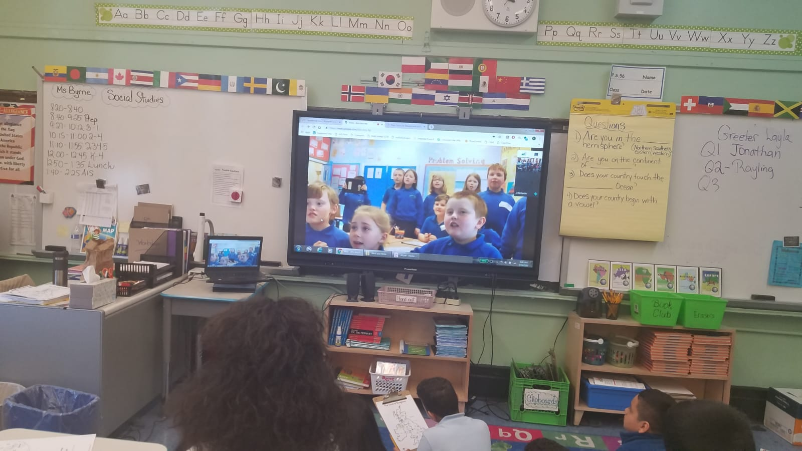 Small group of students  Skype with other students in Wales.
