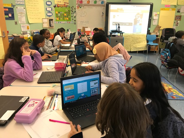 Students learning vocabulary through an online game.