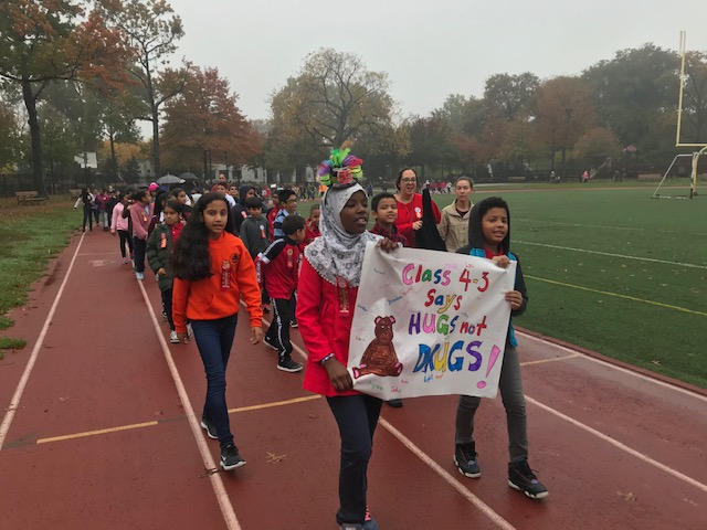 Students march for the Red Ribbon Walk at the local park.