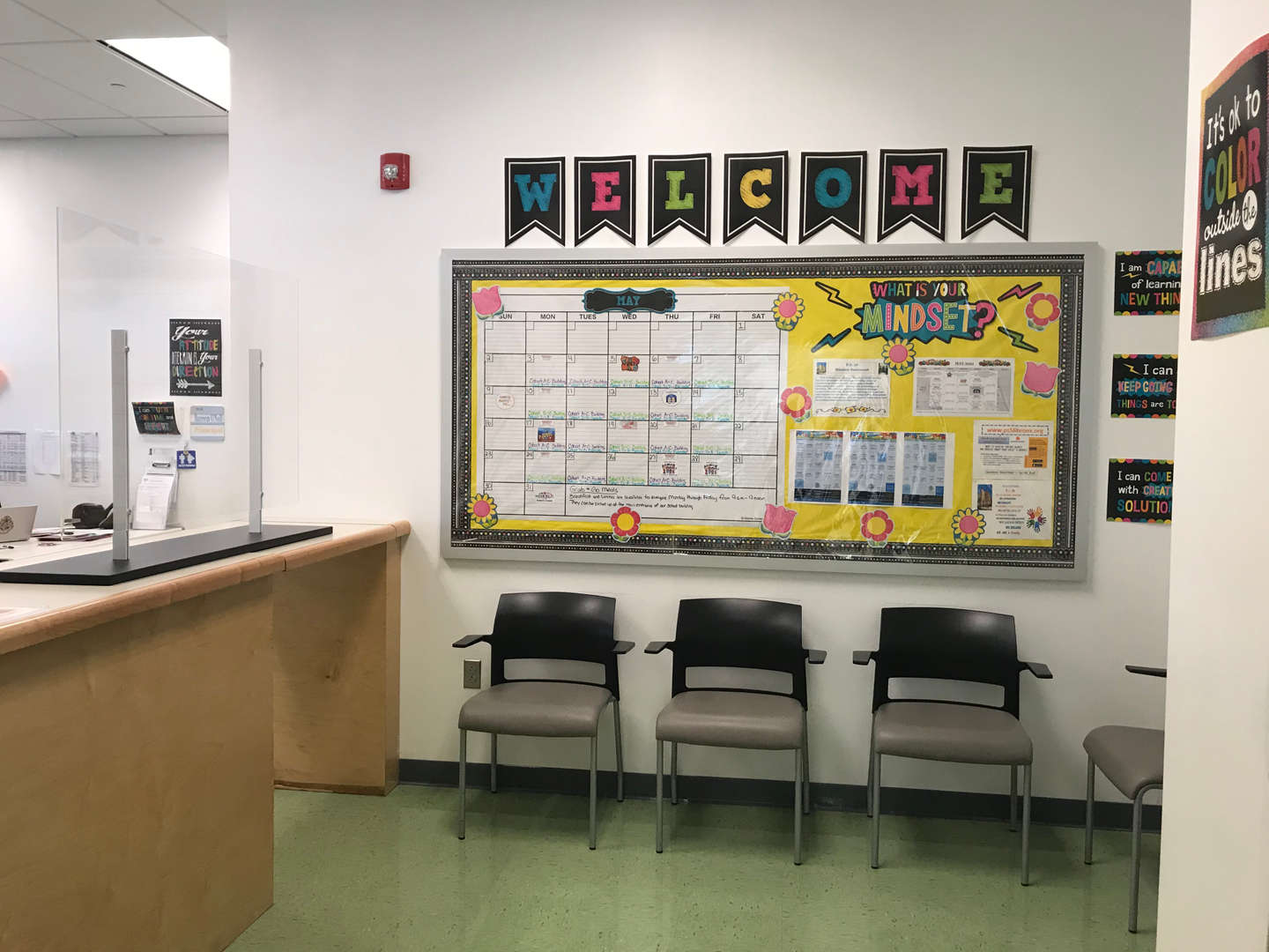 Main office reception area with a bulletin board that displays the school calendar.