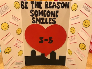 """Be the reason someone smiles"" class poster board."