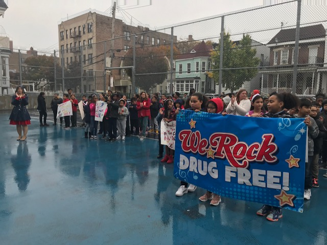 Students in the schoolyard getting ready to march for the annual Red Ribbon Walk.