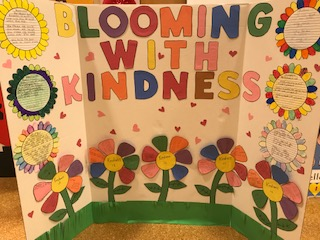 """Glowing with kindness"" class poster board."
