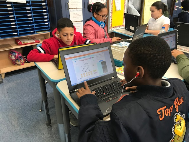 Students practicing their math skills on the computer.