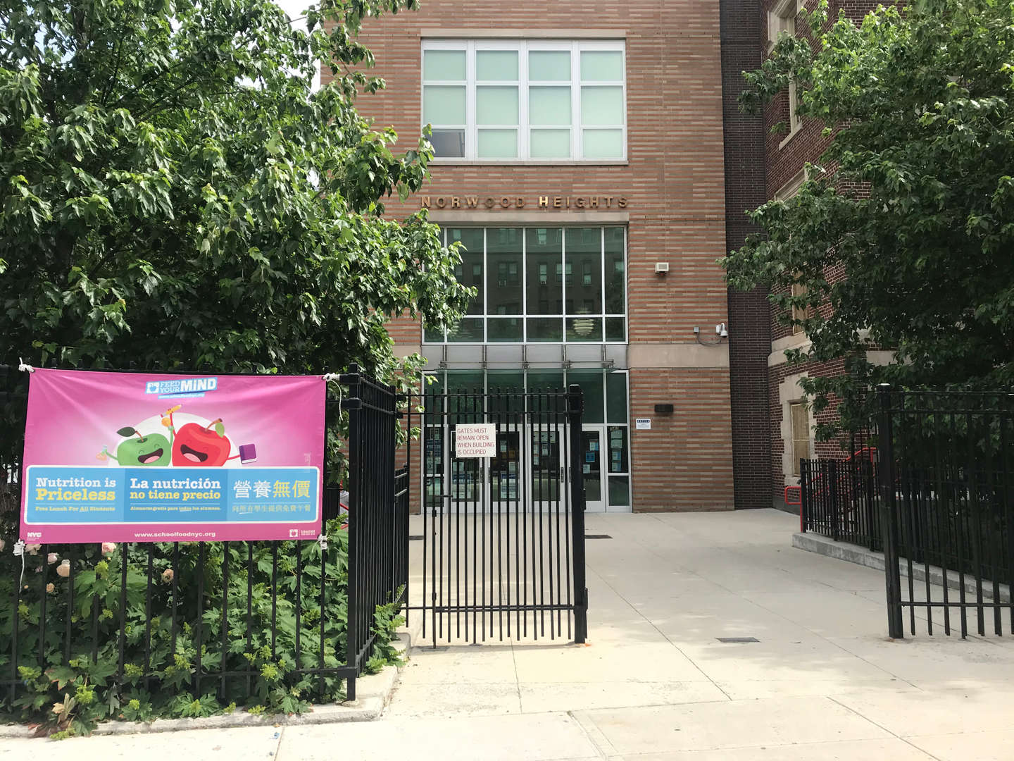 PS 56 entrance way from 207th street nearing the gate.