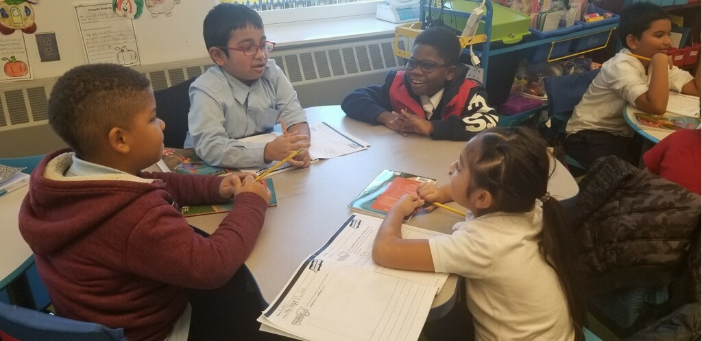 Students have discussions in their group.