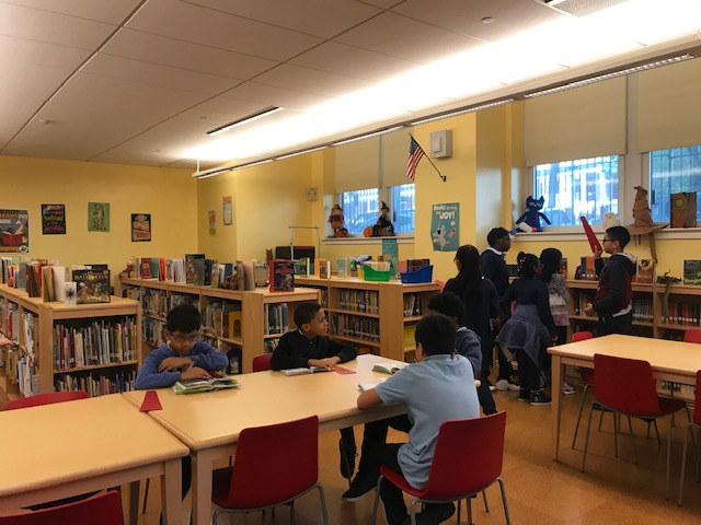 Students reading books in the library.