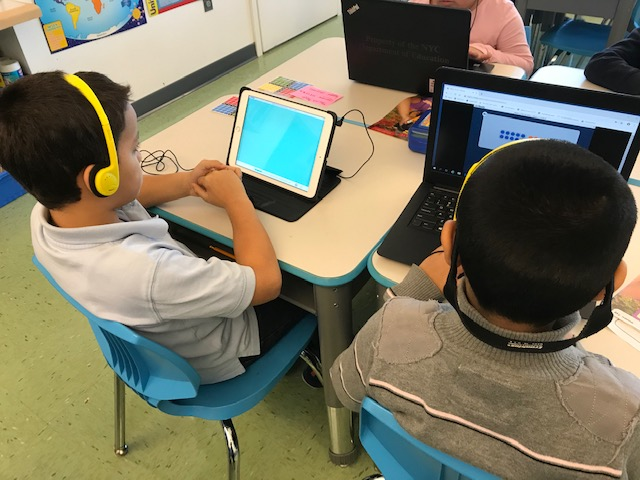 Students learning using tablets.