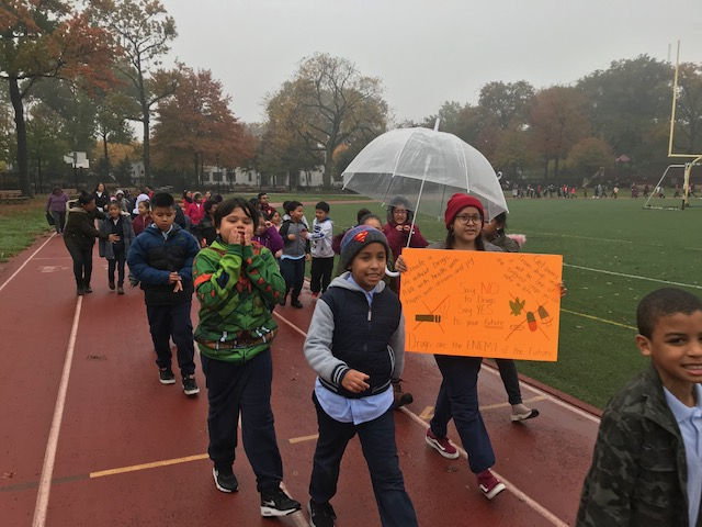 Students and teachers march for the Red Ribbon Walk at the local park.