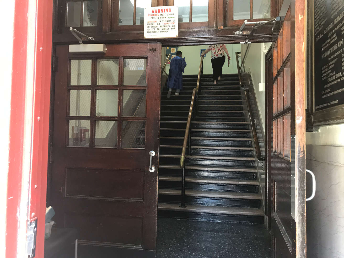 Original side main entrance inside doors before the staircase.