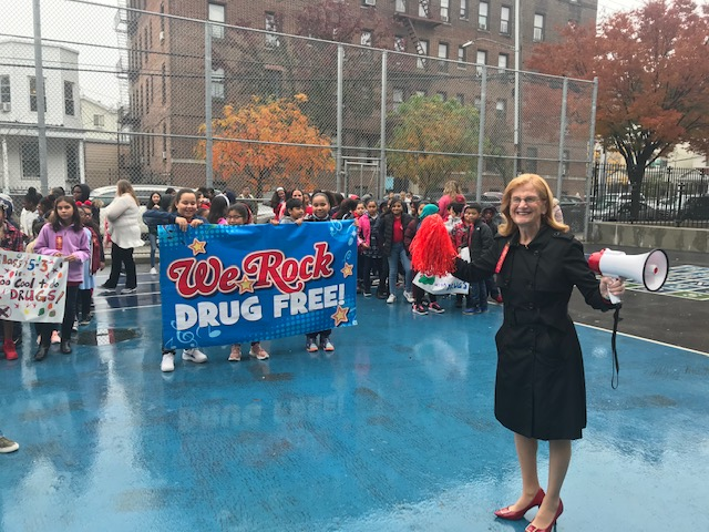 Principal, Maureen O'Neill rallies students for the annual Red Ribbon Week march.