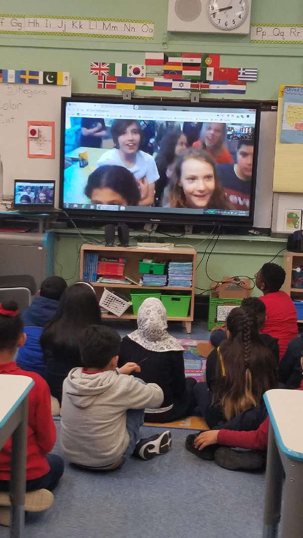 Students Skype  with other students from Australia.