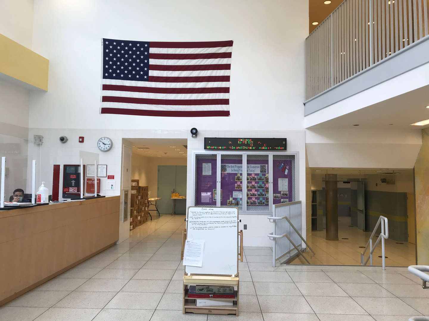 Security lobby displaying a large U.S. flag on the wall above.