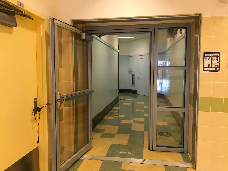 Upper floor hallway door connecting original side from new the new side.