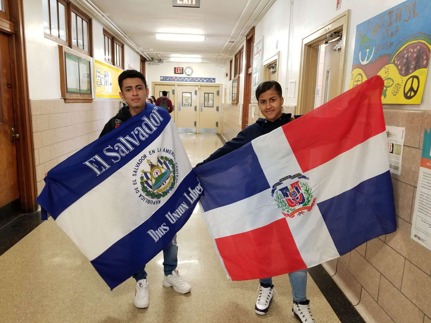 Students displaying their country's flag