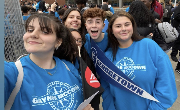 Group of students take a selfie during trip to Georgetown University