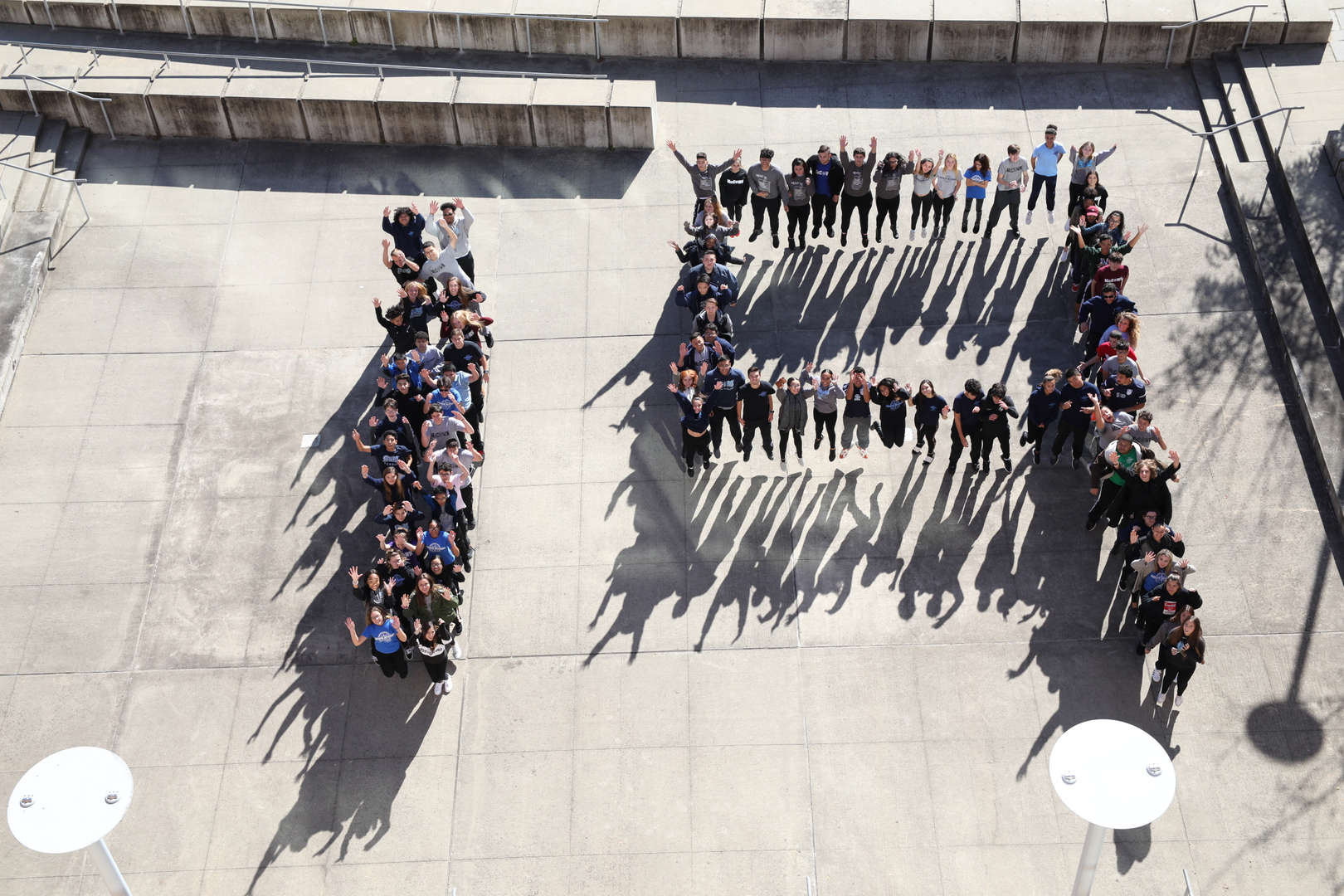 "Aerial shot of students spelling out ""19"""