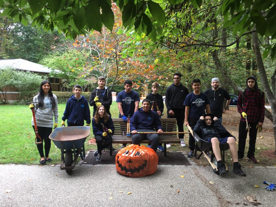 Group of students volunteer outside on Halloween