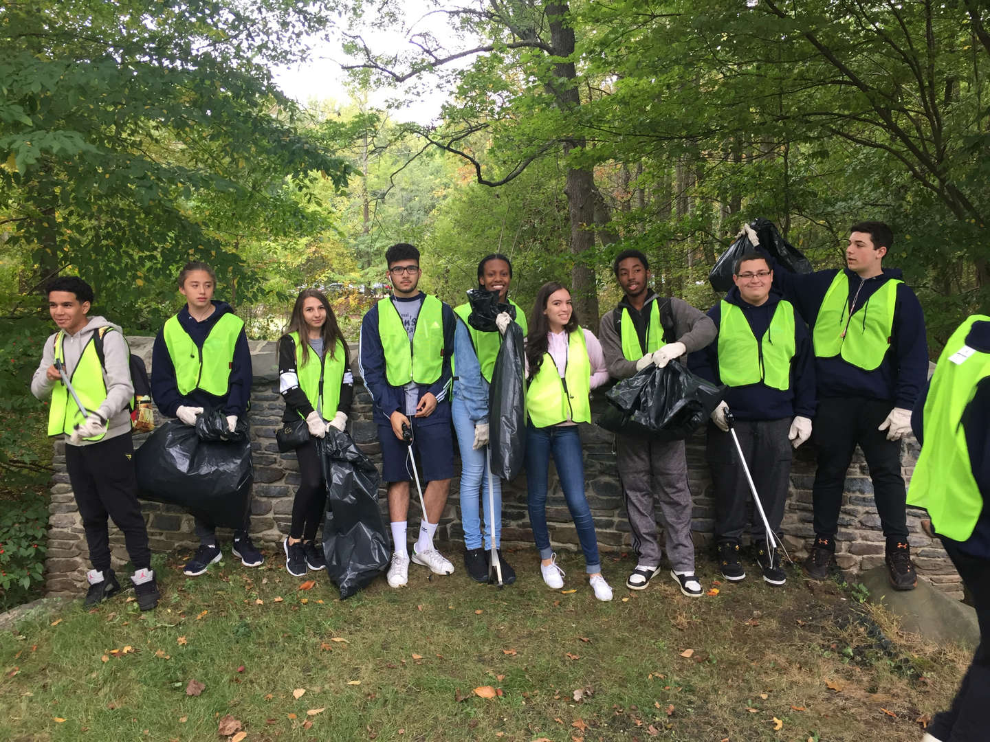 Volunteer students help clean and pick up litter